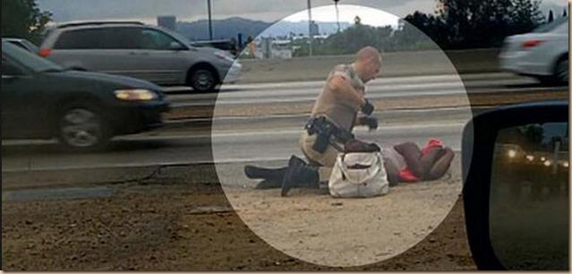cops pugni a donna inoffensiva